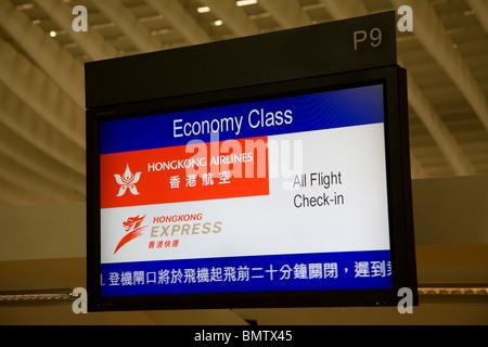 Airasia check in desk sign chek lap kok airport - Stock Photo