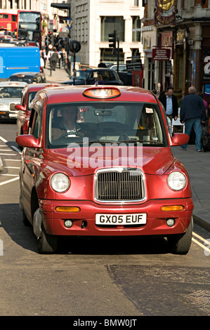 red taxi in the city of london - Stock Photo