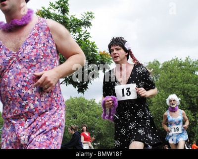 London Fields Hackney London June 19th 2010. Men in dresses run 10 laps of London Fields to raise awareness of Prostrate - Stock Photo