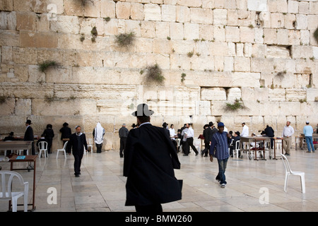 The wailing wall with worshipers in Jewish quarter of Old Jerusalem - Israel - Stock Photo