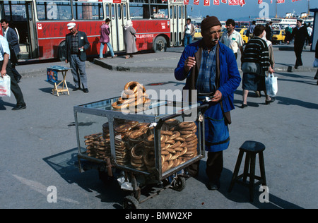 Street vendor selling simit (sesame coated bread rings) in ...