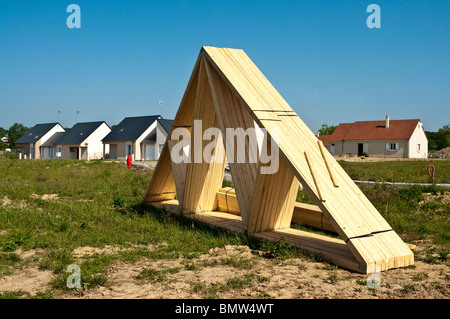 Timber roof trusses on new domestic housing construction building site - Indre-et-Loire, France. - Stock Photo