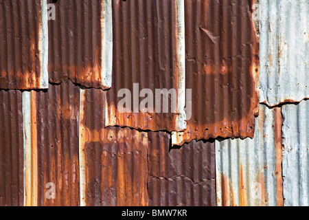 Rusting corrugated iron sheets on wall of shed Texas USA - Stock Photo