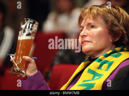 Western Cape Premier HELEN ZILLE holding a glass of bavarian beer - Stock Photo
