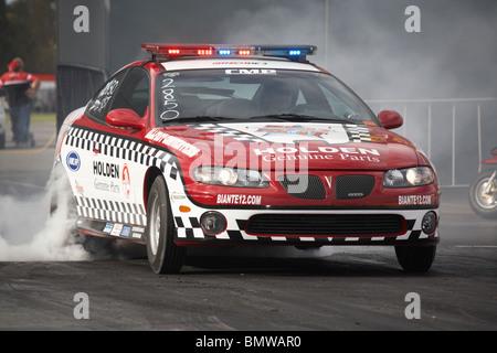 Pontiac GTO police car performing a massive tyre smoking burnout at the Perth Motorplex drag racing facility, Western - Stock Photo