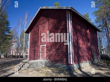 Suonenjoki town museum ( Suonenjoen kotiseutumuseo ) in old grain storage ( granary ) made of logs and painted with - Stock Photo