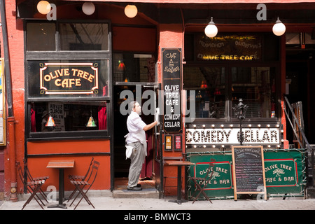 Cafe Employee Readying Place for Opening, Greenwich Village, NYC - Stock Photo