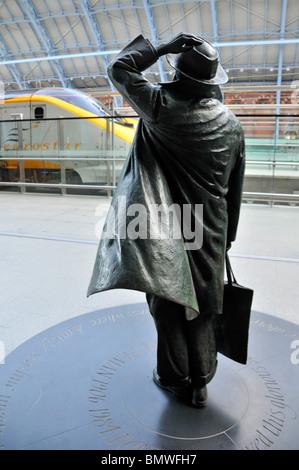 St Pancras International railway station concourse back of bronze statue of Sir John Betjeman by sculptor Martin - Stock Photo