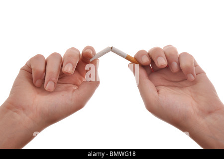 Quit smoking, hands are breaking a cigarette. - Stock Photo