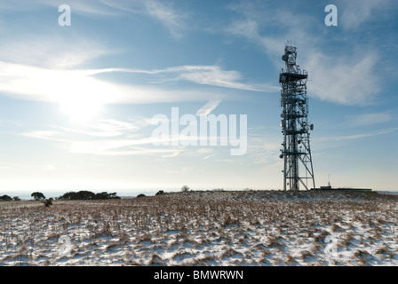 radio and mobile phone mast on a snow covered Butser Hill on the south downs - Stock Photo
