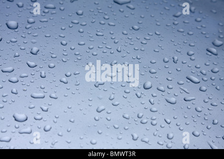 Water droplets on car surface after rain - Stock Photo