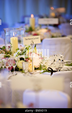 Wedding reception tables laid out in preparation for arrival of guests - Stock Photo