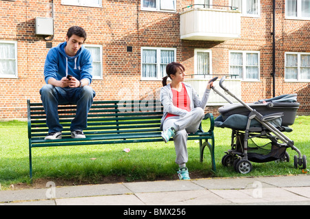 young families and teenage pregnancy - Stock Photo