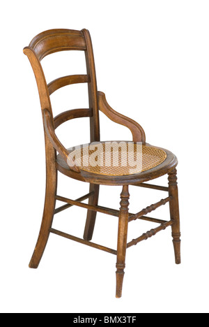 Vintage wood chair with modified arms, ladder-back and cane seat. - Stock Photo