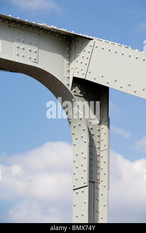 Riveted joints in the iron bridge support structure - Stock Photo