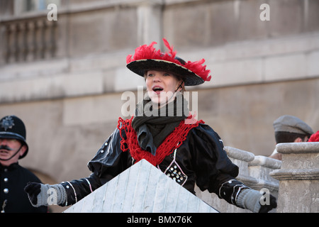 Young woman in Victorian clothes singing in the New Year's Day Parade, Whitehall,  Westminster, London WC2.