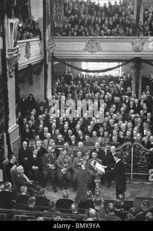 PAUL von HINDENBURG seated left watches as Adolf Hitler as Chancellor reads an address in Potsdam Garrison church - Stock Photo