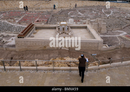 A religious Jew looking at a scale model of Jerusalem in the Second Temple Period placed at the campus of Israel - Stock Photo