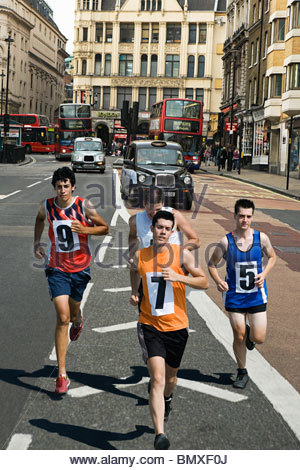 Runners on road in london - Stock Photo