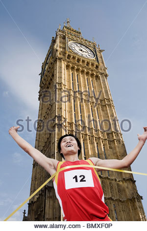 Athlete at finish line by big ben - Stock Photo