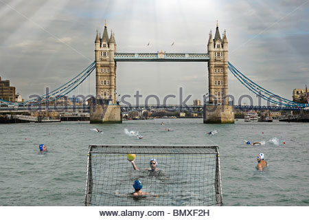 People playing water polo in river thames - Stock Photo