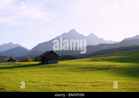 Meadow and karwendel mountains in bavaria - Stock Photo