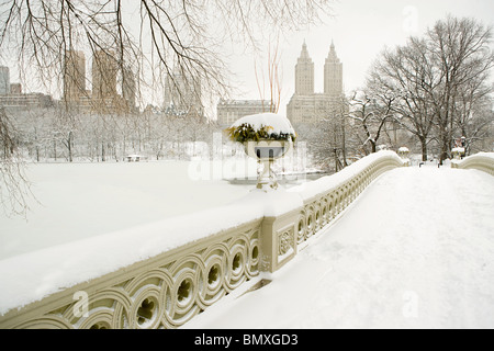 Bow bridge and central park in the snow - Stock Photo