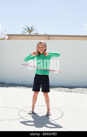 Young girl with hoola hoop - Stock Photo