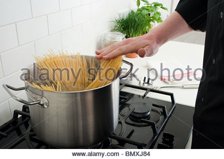 Cooking spaghetti - Stock Photo
