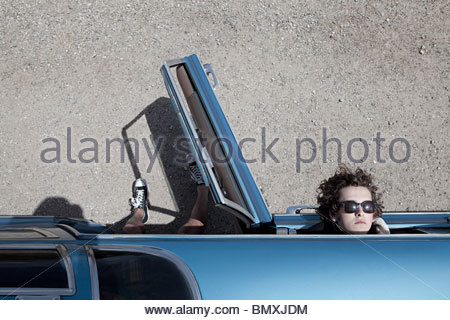 Young people in blue convertible - Stock Photo