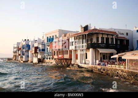 Greece, Cyclades, Mykonos, Mykonos Town, Outdoor Cafe in Little Venice Area - Stock Photo