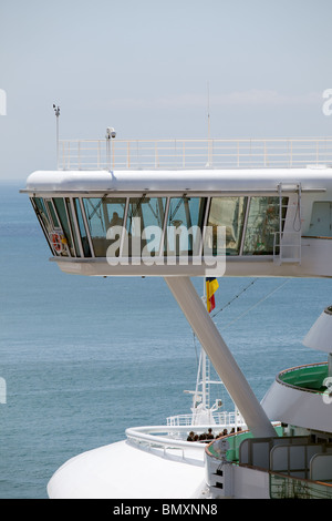 Deck Officer on watch on the Port bridge wing of the P&O liner Azura - Stock Photo