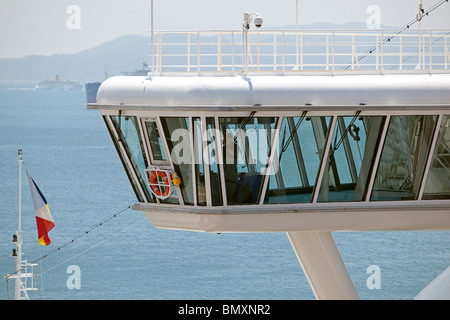 Deck officer on watch on the bridgewing of the Azura. (P&O Liner). Tied up at Gibraltar - Stock Photo