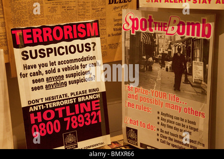 Terrorism posters from the 1970's inside an exhibition about surveillance and security at the Imperial War Museum, - Stock Photo