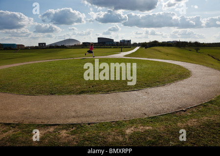 Young girl running around Campbell Park, Milton Keynes, Buckinghamshire. - Stock Photo