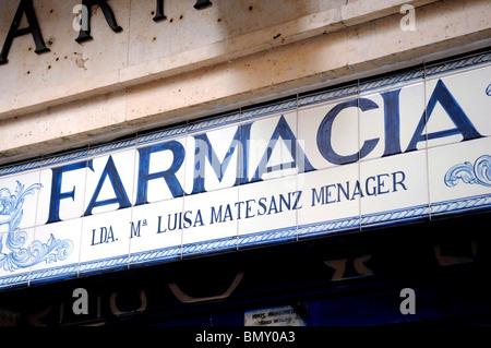 Madrid, Spain. Farmacia El Leon in Calle de Leon. Tiled sign. Pharmacy / chemist shop - Stock Photo
