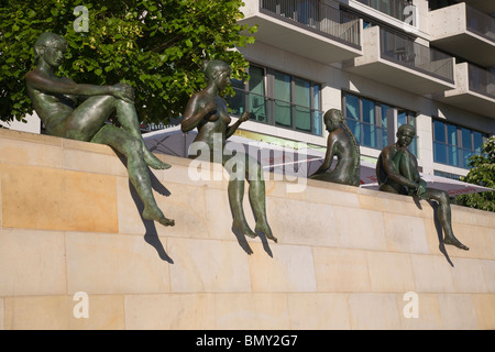 Sunbather statues by River Spree, Berlin, Germany - Stock Photo