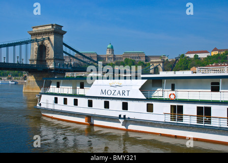 Tourist tour boat in front of Chain Bridge Belvaros central Budapest Hungary Europe - Stock Photo