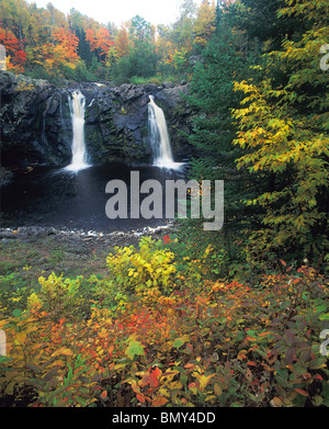Pattison State Park, WI Little Manitou falls on the Black river with hardwood forest in autumn colors - Stock Photo