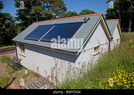 Solar thermal panels on roof of Woody Bay Station Parracombe North Devon UK - Stock Photo