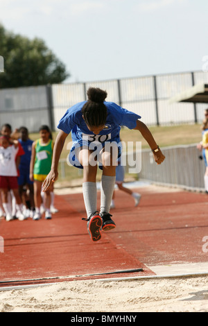 11-12 year olds compete in the Croydon primary schools' athletics championships at Croydon Arena - Stock Photo
