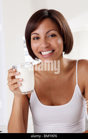 WOMAN WITH GLASS OF MILK - Stock Photo