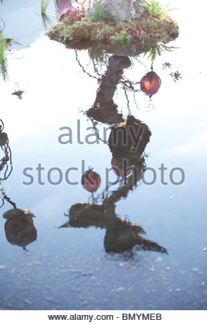 Glastonbury Festival 2010 dragon sculpture reflection - Stock Photo
