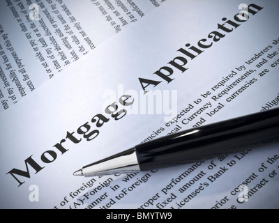 Close up of a mortgage application and a pen. - Stock Photo