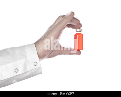 A doctor holds a vial full of red liquid with his latex gloves on. Isolated on white. - Stock Photo
