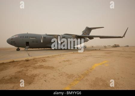 A C-17 Globemaster III sits on the runway at COB Speicher, Iraq. - Stock Photo