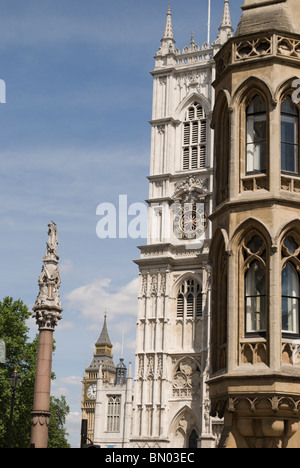 Unusual view of London landmarks: Westminster abbey (St Margaret's church) and Big Ben from Victoria street - Stock Photo
