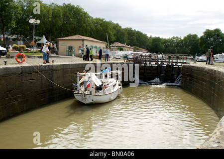 river boat passing through lock on canal du midi in carcassonne - Stock Photo