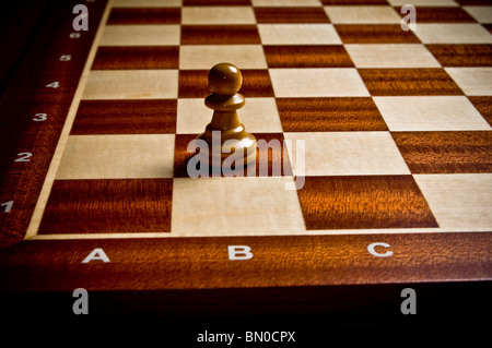 chess piece of Pawn on a chessboard - Stock Photo