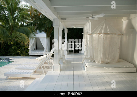 View over Terrace on Pool Area of a House - Stock Photo